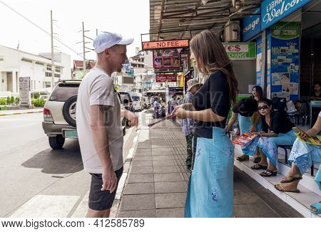 A White Man Arranges With A Thai Masseuse For A Thai Massage Session On The Red Light Street Of Bang
