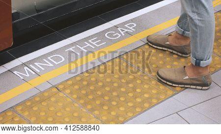 Mind The Gap Sign. Text On Train Station Platform.