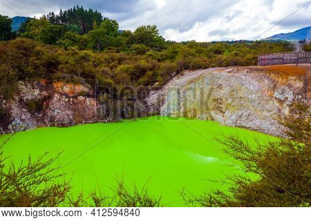 Volcanic Valley Waimangu. Wai-O-Tapu, Devil's Bath with bright green color of water. The unique geothermal area of Rotorua. New Zealand, North Island. Extreme, exotic and photo tourism concept