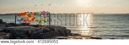 Balloons On Seafront During Sunset, Stock Image