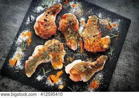 Raw Chicken Wings With Spices Are Marinated On A Stone Board. Buffalo Wings Cooking.