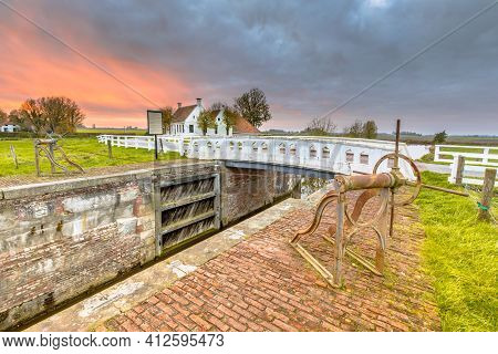 Old Medieval Sluice Built In 1400 Near Aduarderzijl, In The Province Of Groningen, The Netherlands.