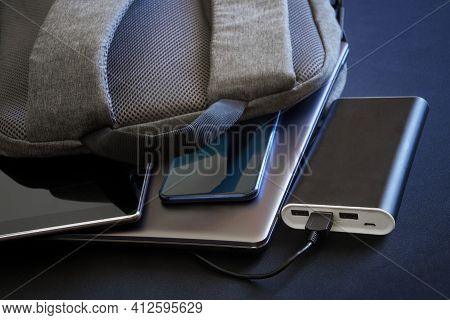 Modern Gadgets - A Smartphone, Tablet And Laptop Or Ultrabook - Lie In A Gray City Backpack Next To