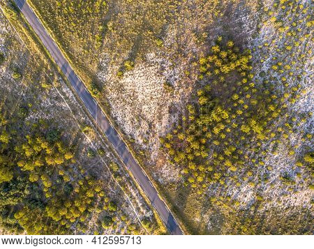 Road Through Sparsely Vegetated Barren Landscape In Cevennes Near Ganges, Occitania, France