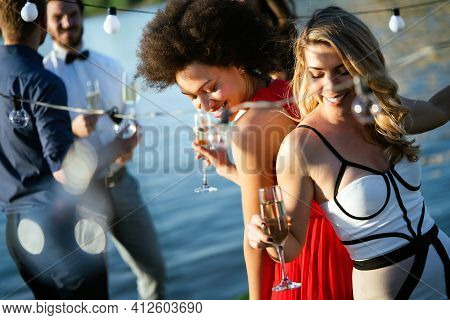 Group Of Beautiful People Friends Celebrating, Dancing And Having Fun Together Outdoor