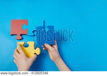 Top View Hands Of A Autistic Child Arranging Color Puzzle Symbol Of Awareness For Autism Spectrum Di
