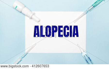 On A Light Blue Background, Syringes, A Medicine Bottle, An Ampoule And A White Sheet Of Paper With