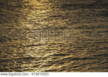 Sunset Water Background, Surface Water In The Sunset Time, Thailand. Nature Concept. Golden Sunset T