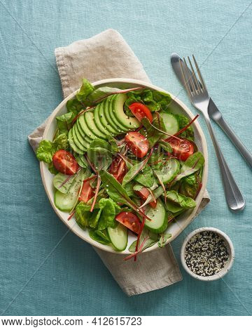 Vegan Salad With Tomatoes, Cucumbers, Avocado On Blue Linen Tablecloth, Vertical. Vegeterian Mediter