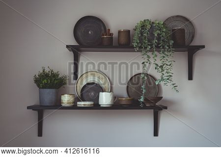 Stylish Open Space Shelves With Authentic Handmade Ceramic Dishes, Plants And Plates. Design Interio
