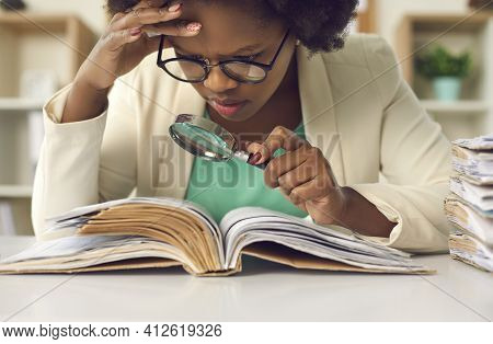 Closeup Concentrated African American Auditor Scrutinizing Financial Documents