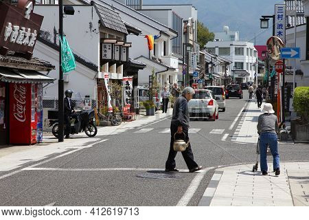 Matsumoto, Japan - May 1, 2012: People Visit Downtown Matsumoto City, Japan. Matsumoto Is The 2nd La