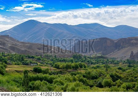 Layers Of Himalayan Mountains Blue Cloudy Sky In Background, View Of Leh Ladakh Landscape, At Mulbek