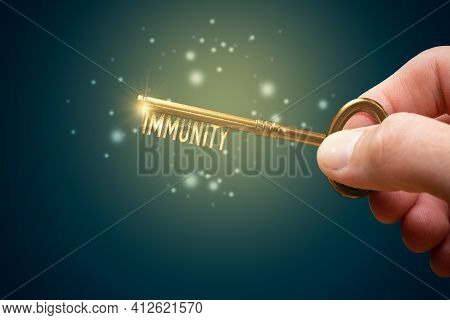 Key To Boost Your Immune System Is In Your Hand. Immunity Improvement Concept. Immunization Is Key T