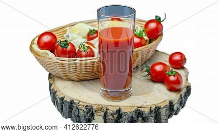Tomato Juice In A Glass Isolated On White. Fresh Tomatoes With Tomato Juice