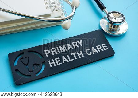 Primary Health Care Sign With Papers And Stethoscope.