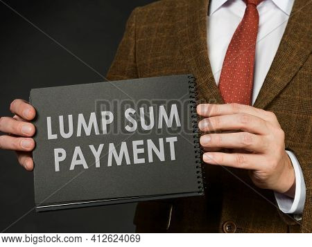 A Man In A Suit Holds An Inscription Lump Sum Payment.