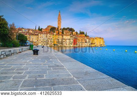 Fantastic Waterfront Walkway With Colorful Old Buildings On The Small Peninsula, Rovinj, Istria, Cro
