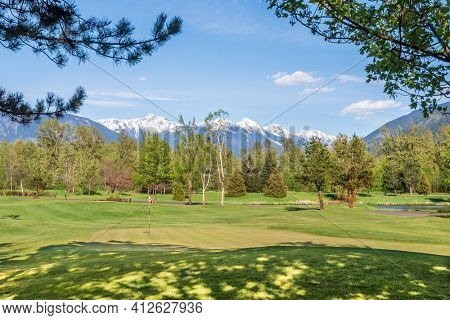 Golf course with gorgeous green and fantastic mountains view.