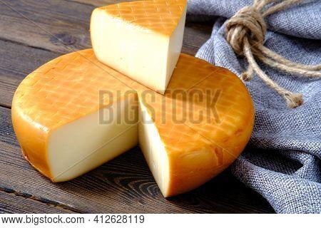 Italian Toma Hard Cheese Seasoning In A Cold And Dark Cellar.