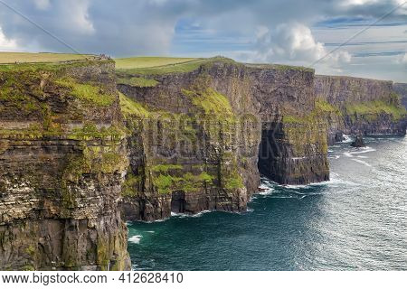 Cliffs Of Moher Are Sea Cliffs Located At The Southwestern Edge Of The Burren Region In County Clare