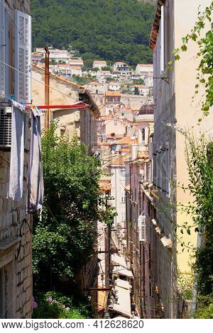 Passage Between Walls To The Old Town, The Historical Part Of The City. Between Walls Of Houses, Roo