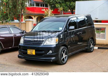 Arusha, Tanzania - February 6, 2021: Black Minivan Toyota Noah R60 In The City Street.