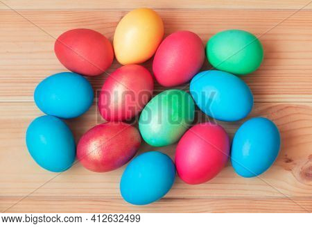 Colorful Easter Eggs On Wooden Table. Top View.