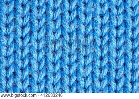 Photo Of Light Blue Knitting Texture For Universal Application. Textural Background Top View Of Brig