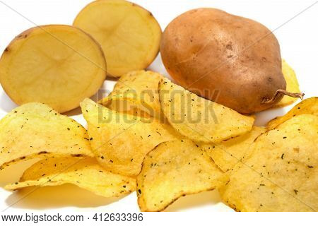Potato Crisps With Spices And Potatoes On A White Background. Potato Chips Close-up.
