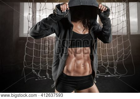 No Name Portrait Of A Woman With A Beautiful Abs In A Sweatshirt In The Gym. Fitness, Bodybuilding,