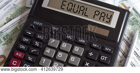 Calculator With The Word Equal Pay On Display