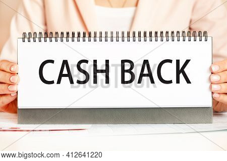 Businessman Showing Text Cash Back On A Cardboard