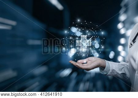 Doctor Showing A Hologram Of Quality Medical Care On A Blurred Background.