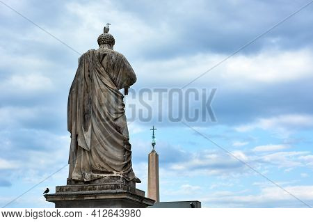 View Of The Back Of The Sculpture Of Saint Peter And Obelisk At Saint Peter\'s Square In The Vatican