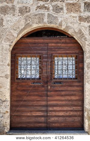 Arched doorway with double wooden doors, Italian Architecture - Umbria