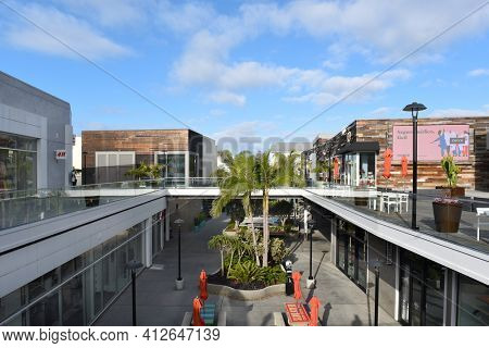 HUNTINGTON BEACH, CALIFORNIA - 22 JAN 2020: Shops and restaurants at Pacific City. The upscale development is on the Pacific Coast Highway.