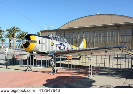 IRVINE, CA - FEBRUARY 10, 2015: Plane and Hangar at the Orange County Great Park. An SNJ-5 Texan WWII era plane on display at the Great Park in Irvine, California.