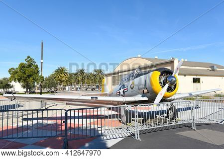 IRVINE, CALIFORNIA 31 JAN 2020: An SNJ-5 Texan WWII era plane on display in front of the hangar and Palm Court at the Orange County Great Park.