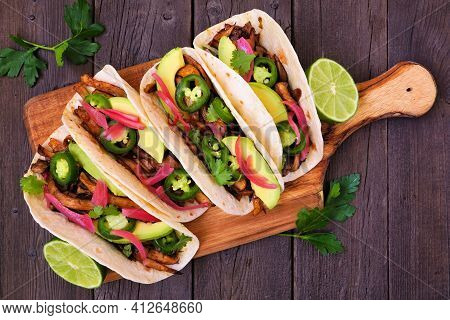 Vegan Mushroom Tacos. Serving Board, Above View On A Dark Wood Background. Healthy Eating, Plant Bas