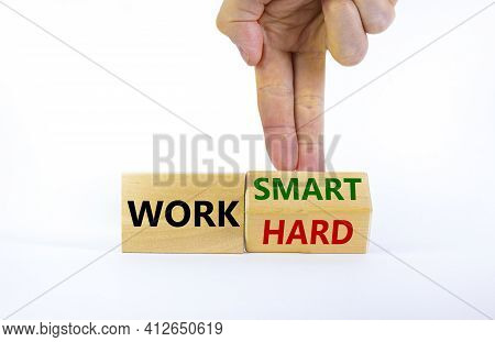 Work Hard Or Smart Symbol. Businessman Turns Wooden Block And Changes Words 'work Hard' To 'work Sma