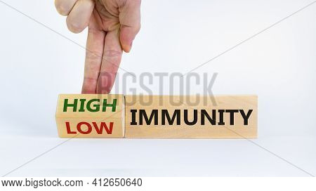 High Or Low Immunity Symbol. Doctor Turns A Block And Changes Words 'low Immunity' To 'high Immunity