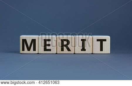 Merit Symbol. Wooden Cubes With The Word 'merit'. Beautiful Grey Background, Copy Space. Business An