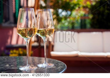 Glass Of Chilled White Wine On Table Over Tuscany Backgound