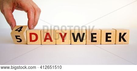 4 Or 5 Work Day Per Week Symbol. Businessman Turns The Cube And Changes Words '5 Day Week' To '4 Day