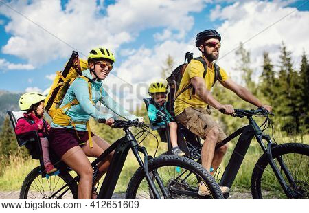 Family With Small Children Cycling Outdoors In Summer Nature, High Tatras In Slovakia.