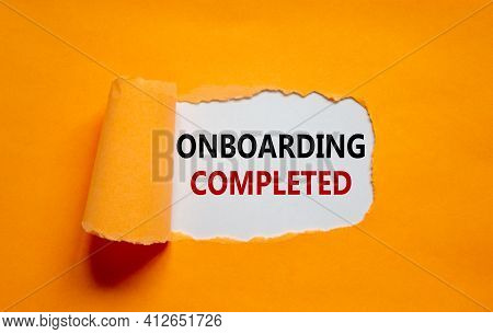 Onboarding Completed Symbol. Words 'onboarding Completed' Appearing Behind Torn Orange Paper. Beauti