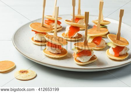 An Original Delicious Snack For Home Parties And Receptions. Mini Pancakes With Cream Cheese And Sal