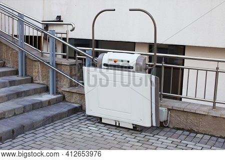 Stair Lift For The Disabled. Lift On The Street Near The Stairs For People With Disabilities.