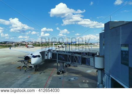 Guarulhos, Brazil - February 16, 2021: External View Of Guarulhos Airport With Passengers Boarding A